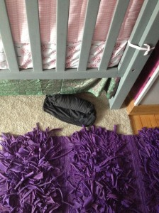 That is a maternity shirt UNDER THE CRIB.  At first I thought it was sign but it turned out to be my stupid cat.