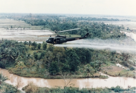 U.S. Army Huey helicopter spraying Agent Orange over Vietnamese agricultural land. - via Wikipedia  *WARNING* Disturbing images upon link.